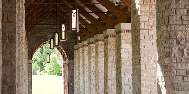 The stony Brickman Colonnade with the lanterns lit