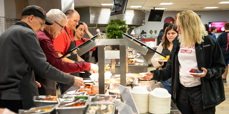 Bryn Athyn College Students select food for meal