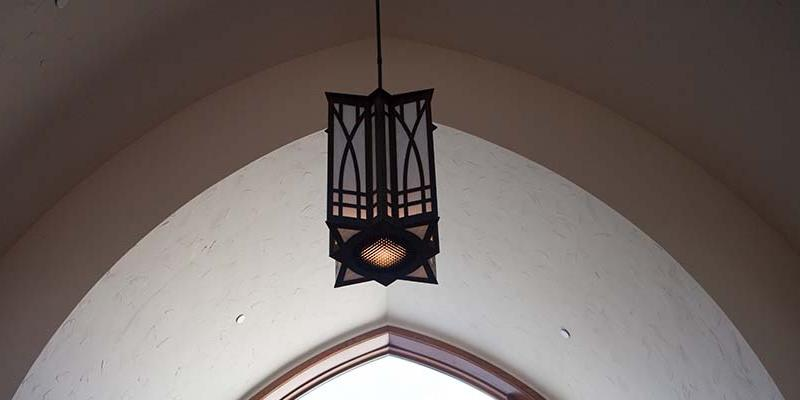 Bryn Athyn College lantern hanging from arched ceiling
